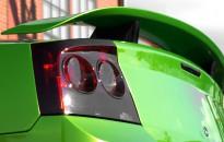 """Dodge Charger SRT8 Individual - Komplettlackierung in """"electric green Perleffekt"""" mit Kontrastteilen in Klavierlack schwarz, abgedunkelte Frontblinker & Rückleuchten, Komplettaufbau nach schlecht behobenem Unfallschaden, Reparatur, Sonderrädern in 22"""", KW Suspensions Gewindefahrwerk, Sportabgasanlage mit geänderten Katalysatoren, Modifikation der Motorhaube (Active Air Intake) etc."""